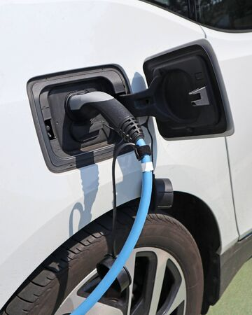 Car at the electric charging station