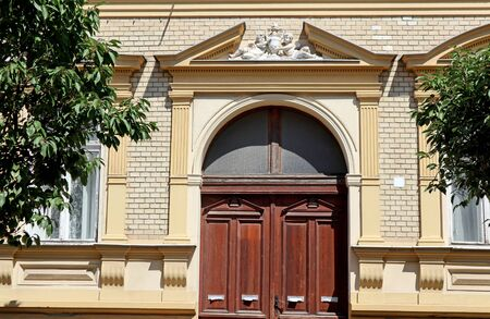 Wall and door of an old ornate building