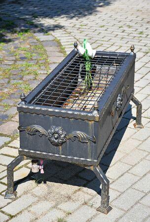 Metal burner in the public cemetery Reklamní fotografie