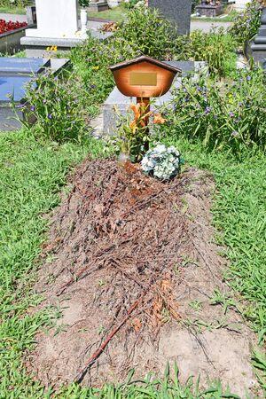 Head stone in the public cemetery Reklamní fotografie