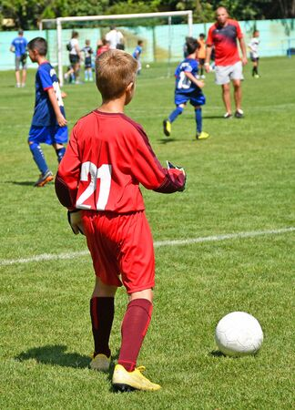 Young soccer player with a ball