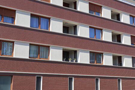 Windows of a modern apartment building Foto de archivo - 131363553