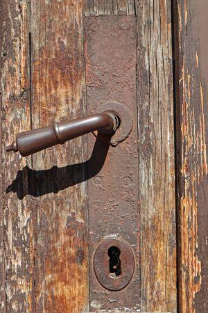 Door handle of an old wooden door Reklamní fotografie
