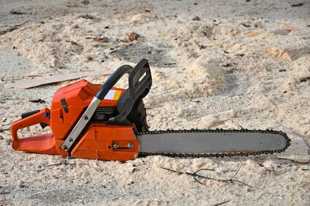 Chainsaw on the ground after work