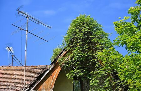 House roof with television antennas