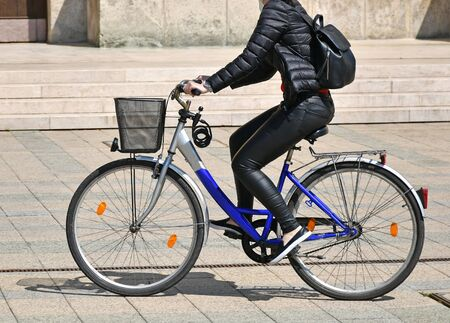 Woman rides a bicycle in the city