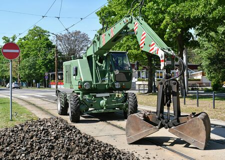 Grabber excavator stands at the railway construction Banco de Imagens
