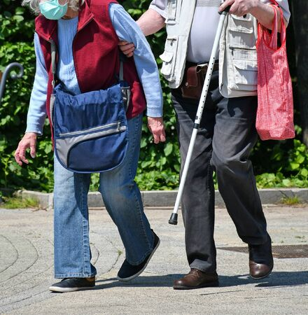 Senior couple walk wearing protective face mask Banco de Imagens