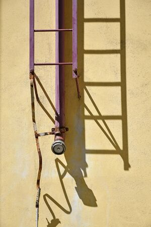 Firefighter ladder and pipeline on the building Banco de Imagens