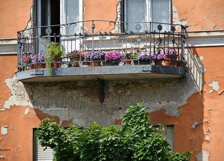 Balcony of an old house with flowers