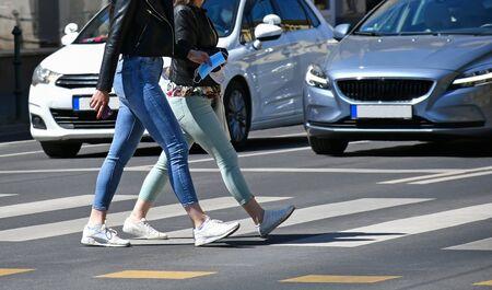 Women are walking on the pedestrian crossing