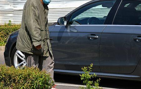 Homeless man asking money on the road
