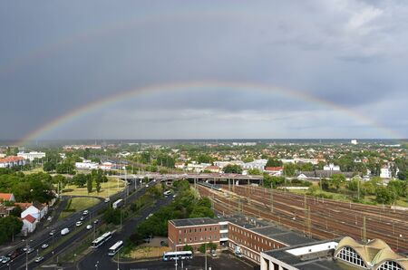 View of Debrecen city with rainbow, Hungary, after summer shower Banco de Imagens