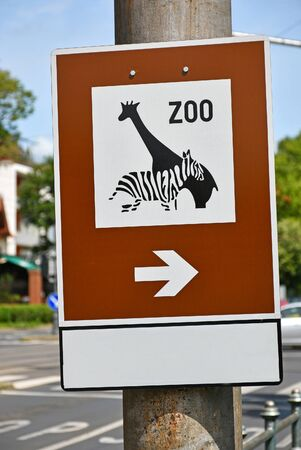 Zoo traffic sign on a pole in the city