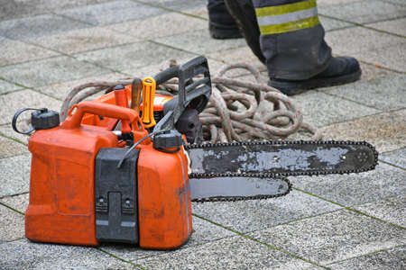 Chainsaw rope and oil tank on the paving stone