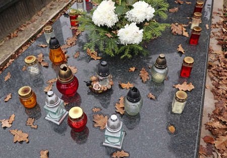 Lanterns on the tombstone in the cemetery