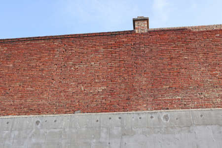 Brick and concrete wall with smoke stack