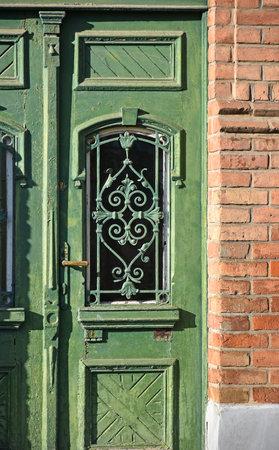 Old green wooden door of a building
