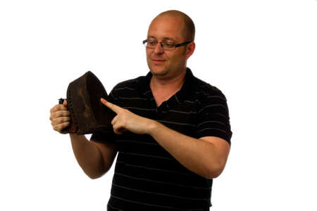 unforeseen: Funny amazed man in glasses and causial shirt holding old rusty iron isolated on white background Stock Photo