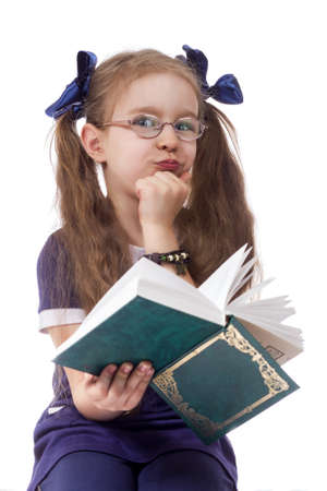 little girl with book wearing glasses isolated white background photo