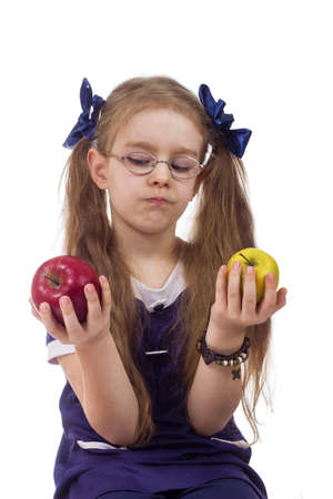 litle: litle girl chooses apples isolated white background