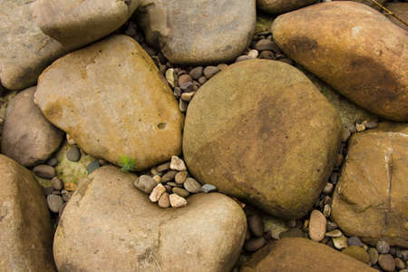 roundish: Stones background. Natural minerals in the mountains