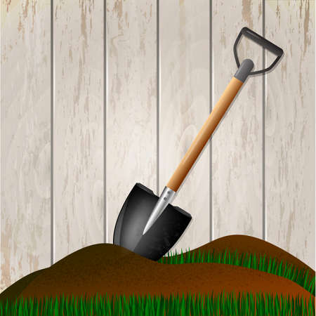 Shovel in the ground. Gardening tool on wooden fence background. Isolated shovel in heap of soil