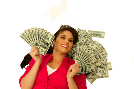 Woman smiles as she holds fans made of 100 dollar bills. Stock Photo - 8967063