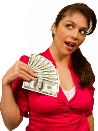 Woman smiles as she holds a money fan of 100 dollar bills.
