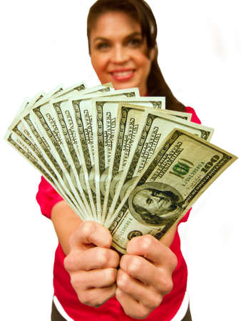 Woman smiles as she holds a hundred dollar bills fan with two hands.