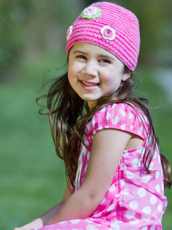 Pretty young girl smiling dressed in pink photo