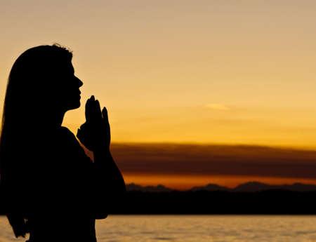 meditates: Woman meditates outdoors Stock Photo