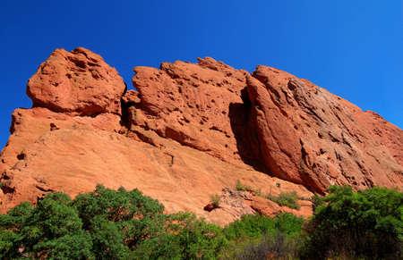 ascend: Climbers ascend steep rock mountain face