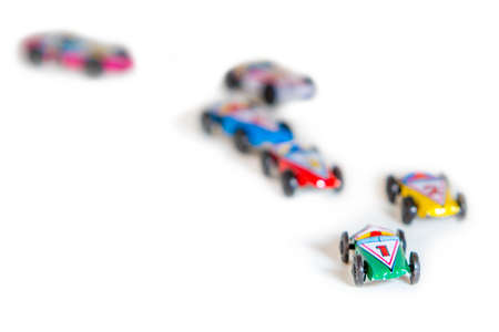 Colorful tin toy race cars ideal for concepts photo