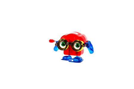 Windup toy binoculars puts on eyeglasses photo