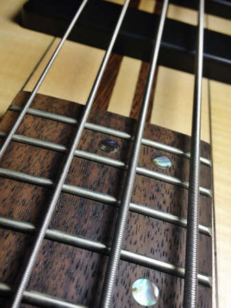 Musical or artistic abstract from electric bass guitar Stock Photo