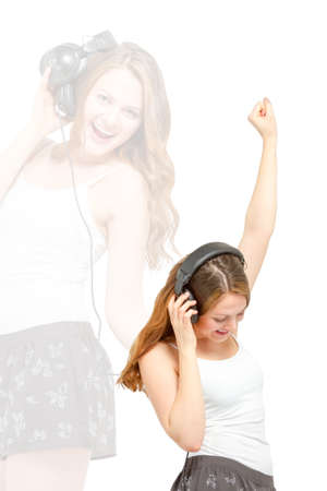 downloadable: Female in casual wear having fun listening to headphones