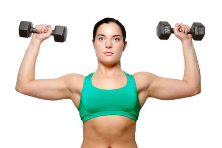 free weights: Female exercies with free weights to build a toned and shapley figure Stock Photo