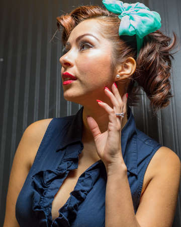 modest: Attractive female in vintage or retro modest yet fun fashion style Stock Photo