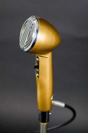 corded: Dusty vintage corded microphone on stand