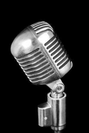 corded: Retro microphone isolated on black background