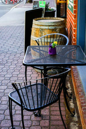 dining table and chairs: Coffeehouse provides wrought iron table and chairs for outdoor dining experience.