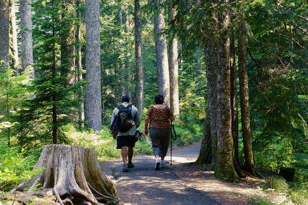 regimen: Hispanic Man And Woman On Day Hike Stock Photo