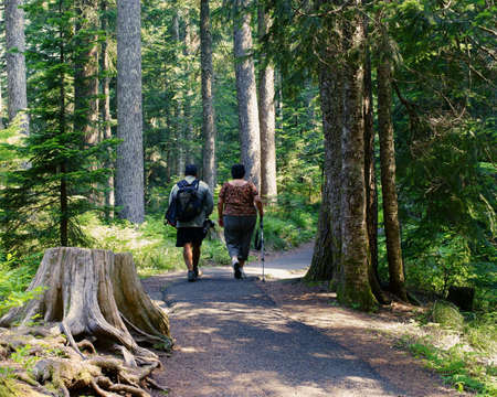 Hispanic Man And Woman On Day Hike Archivio Fotografico