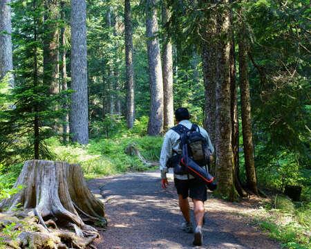 Male Photographer Hiking Toward Destination For Photos