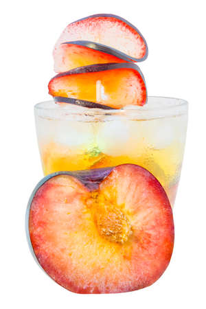 Sparking iced plum flavored drink with plum slice toppings and chunks