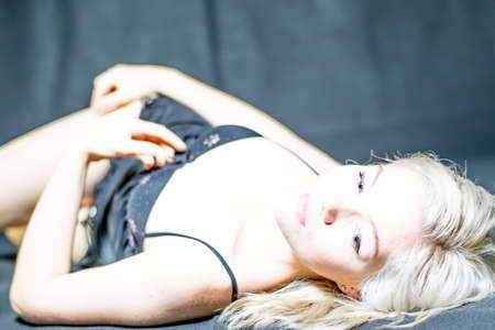 tasteful: Young blonde female modeling tasteful boudoir