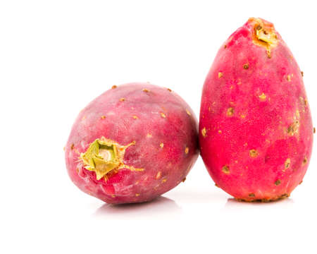 Red prickly pears on plate and isolated white background