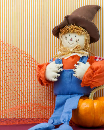 Seated Silly Scarecrow holds its overalls britches photo