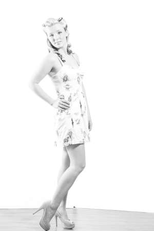 platinum hair: Young attractive woman in short modest dress on isolated white background